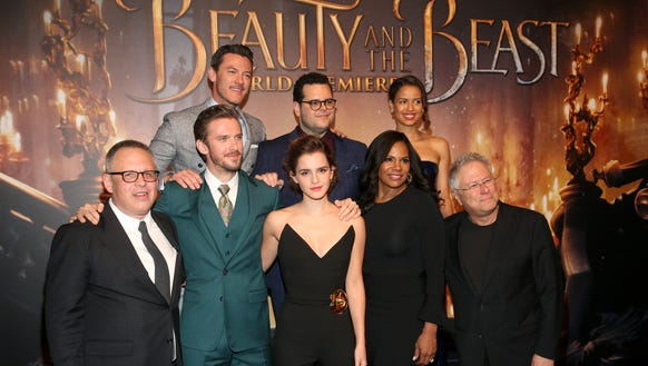 Director Bill Condon, left, poses with, on the top