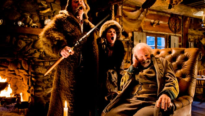 "Kurt Russell, from left, Jennifer Jason Leigh and Bruce Dern in a scene from the film, ""The Hateful Eight.""  The movie opens in U.S. theaters on Jan. 1, 2016."