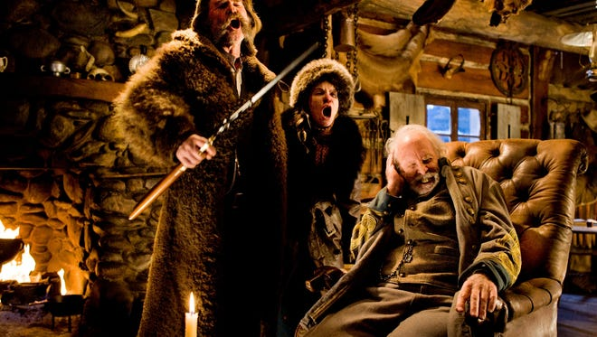 """This image released by The Weinstein Company shows Kurt Russell, from left, Jennifer Jason Leigh and Bruce Dern in a scene from the film, """"The Hateful Eight.""""  The movie opens in U.S. theaters on Jan. 1, 2016. (Andrew Cooper/The Weinstein Company via AP)"""