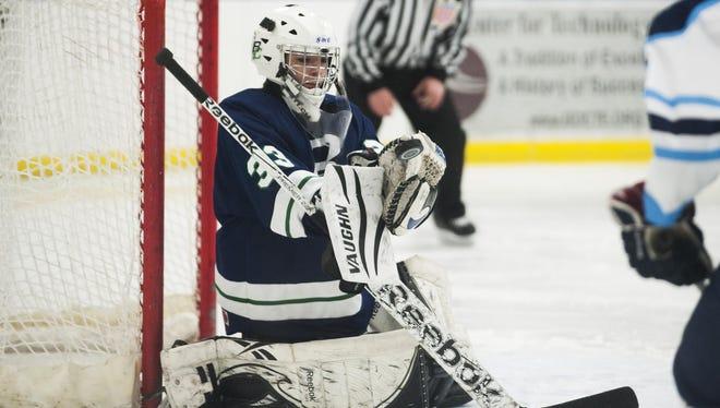 Burlington/Colchester goalie Jenna Blondin (33) makes a save during a playoff hockey game last season.