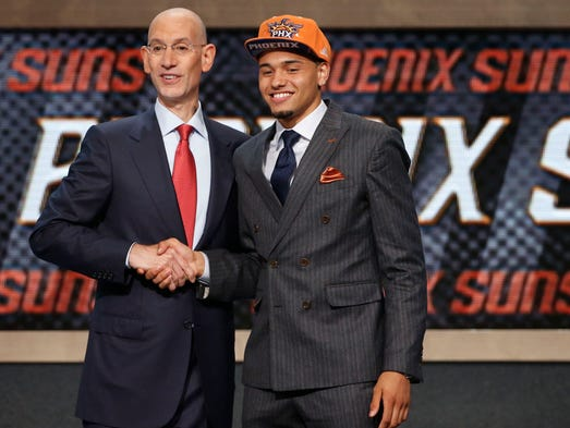 Syracuse's Tyler Ennis poses for a photo with NBA commissioner Adam Silver after being selected 18th overall by the Phoenix Suns during the 2014 NBA draft, Thursday, June 26, 2014, in New York.