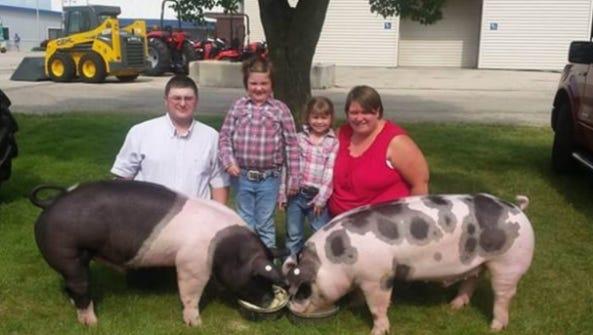 Karlene Krueger (right) with her family, husband Scott