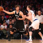 Brooklyn Nets center Brook Lopez (11) controls the ball against New York Knicks power forward Jason Smith (14) during the third quarter at Madison Square Garden. The Nets defeated the Knicks 100-98.