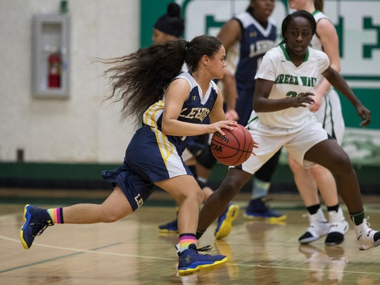 Lekeyshka Benetiz, of Lehigh Senior High School, makes a strong move to the basket as she drives by her defender during the game Friday evening against Fort Myers High School. Fort Myers won with a final score of 58-44.