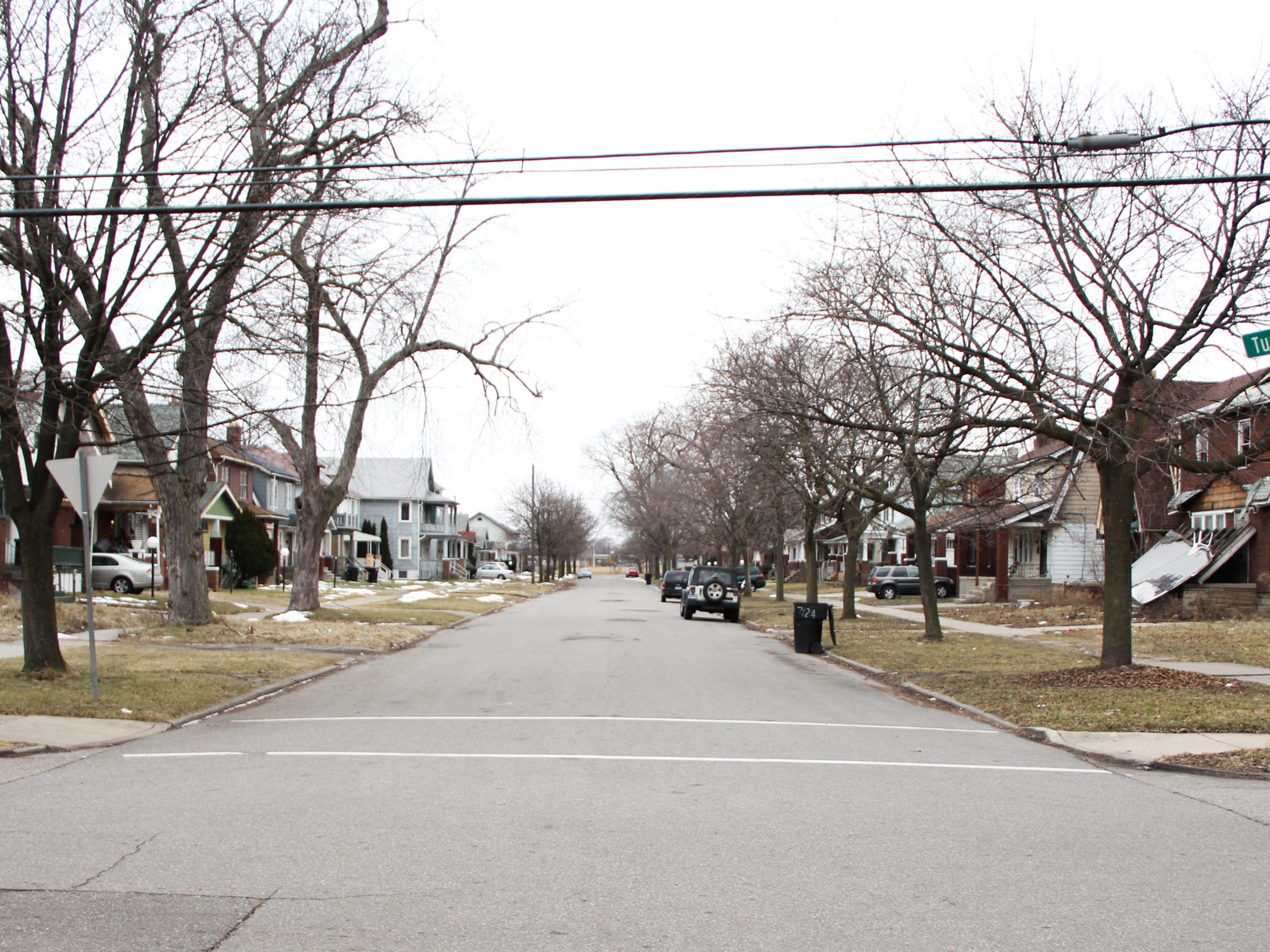 The corner of Tuxedo and Monica streets in Detroit, near 7124 Tuxedo, where Free Press Editorial Page Editor Stephen Henderson's family lived when he was born in 1970. City officials estimate 15 houses on the block are empty and in need of either demolition or renovation. Henderson hopes to remake the house at 7124 as a writer's residence and literary center for the neighborhood.