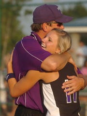 TCA's Olivia Wilson gets a hug from coach Robert Craft