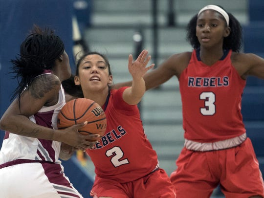 Saddle River Day's Carolyn Carrera (2) works to block University's Danielle Robinson from the basket during first half action. University High vs Saddle River Girls Basketball in NJSIAA quarterfinal game at Toms River on March 14, 2018
