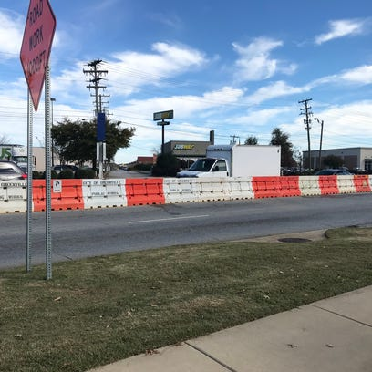 Barriers are in place on Woodruff Road to limit left