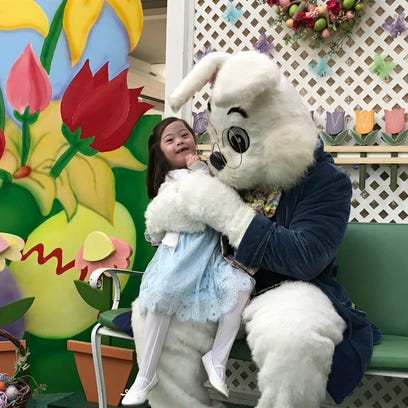 Cara Gehlert, 6, poses with the Easter Bunny on Sunday.