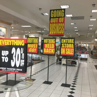 Discount signs greet shoppers at the Younkers in Valley