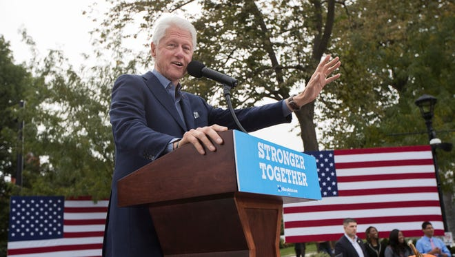 Former President Bill Clinton campaigns for his wife, Democratic presidential candidate Hillary Clinton, at Washington Park in Over-the-Rhine in Cincinnati on Friday