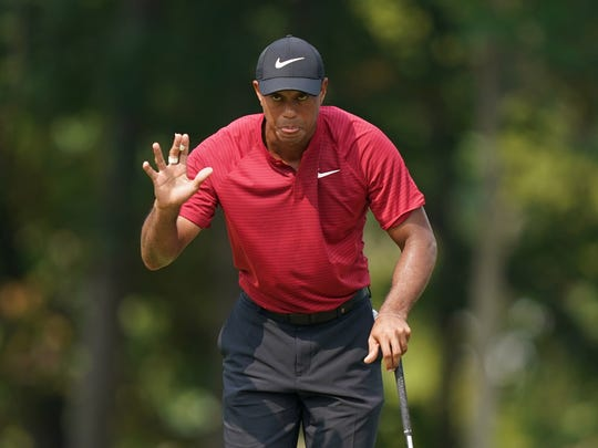 Aug 12, 2018; Saint Louis, MO, USA; Tiger Woods waves to the crowd on the 9th green during the final round of the PGA Championship golf tournament at Bellerive Country Club. Mandatory Credit: Kyle Terada-USA TODAY Sports