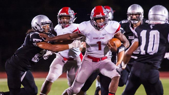 Vineland quarterback Isaih Pacheco (1) rushes against Egg Harbor Township at Egg Harbor Township High School on Saturday, September 23.