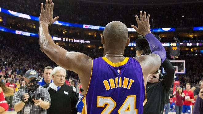 Los Angeles Lakers forward Kobe Bryant waves goodbye to fans at Wells Fargo Center after a game against the Philadelphia 76ers. The 76ers won 103-91.