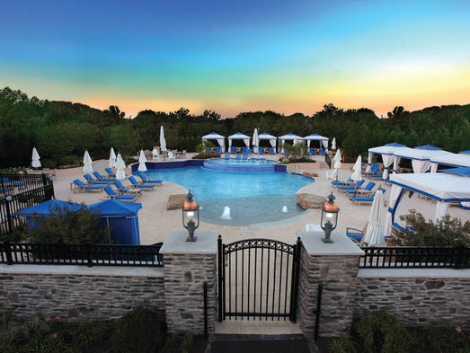 A zero-entry saline pool, surrounded by cabanas with flat-screen televisions and a full-service grill and bar, and tennis courts are also on the site.