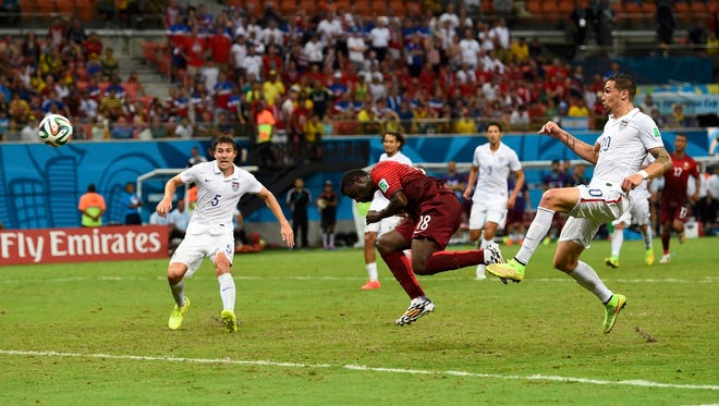 Portugal's Varela heads the ball to score a tying goal with just seconds left in the match Sunday.