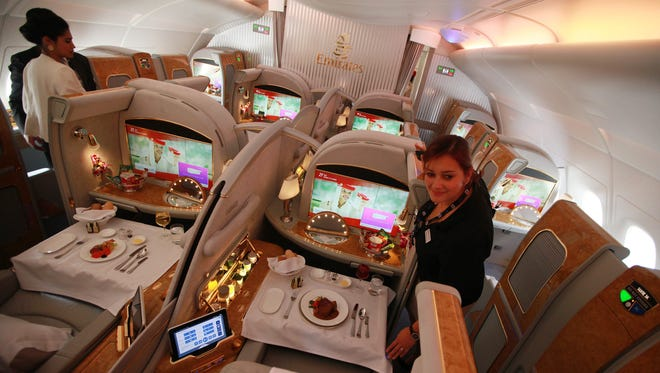 Visitors inspect first-class cabins of an Emirates Airlines' Airbus A380 on display at the Dubai Air show 2013 exhibition.