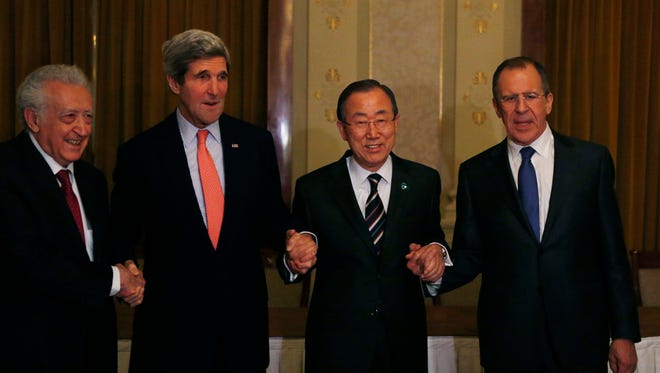 From left: UN-Arab League Envoy to Syria Lakhdar Brahimi, United States Secretary of State John Kerry, UN Secretary-General Ban Ki-moon and Russia's Foreign Minister Sergey Lavrov join hands after their international conference on ending the crisis in Syria in Montreux, Switzerland, Tuesday.