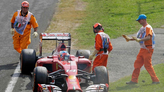 Fernando Alonso slides to a stop after a mechanical failure Sunday at the Italian Grand Prix.