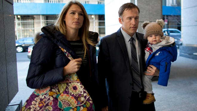 Olympic skier Bode Miller arrives with his wife Morgan and his son at Manhattan's Family Court in New York on Monday.