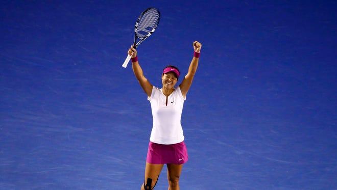 Li Na of China celebrates after defeating Dominika Cibulkova of Slovakia 7-6 (7-3), 6-0 to win the Australian Open.