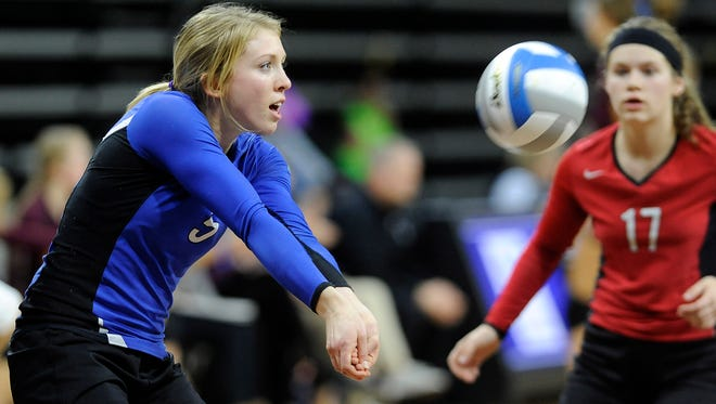 Sioux Falls Christian's #5 Shelby Zomermaand bumps the volleyball against Milbank during state volleyball action at the Denny Sanford Premier Center in Sioux Falls, S.D., Thursday, Nov. 19, 2015.