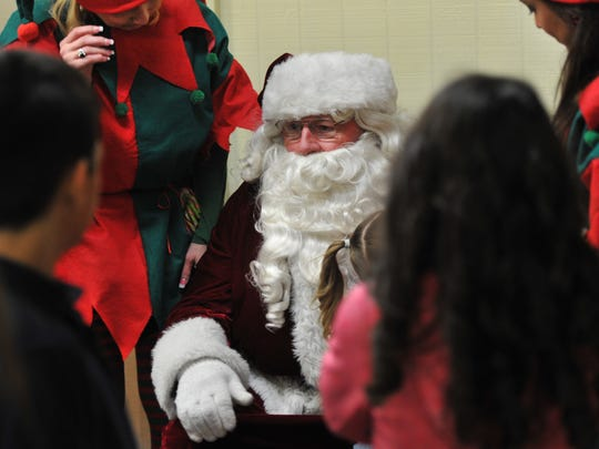 Santa Claus and his helpers handed out toys and gifts