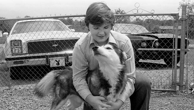 Bill Pearl is quite fond of Pando, his Siberian husky, as he demonstrates May 12, 1978, with an affectionate hug. But Pando presents problems at time, like eating the money Bill set aside for a Mother's Day present. Pando has eaten newspapers, shoes, all types of clothing and the garden hose.