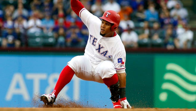 Rangers center fielder Carlos Gomez (14) slides into second base with a double in the first inning against the Los Angeles Angels at Globe Life Park in Arlington.