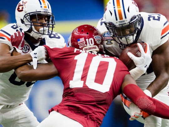 Auburn running back Kerryon Johnson (21) hits Oklahoma safety Steven Parker (10) during the Sugar Bowl between Auburn and Oklahoma on Monday, Jan. 2, 2017, at the Super Dome in New Orleans, La.