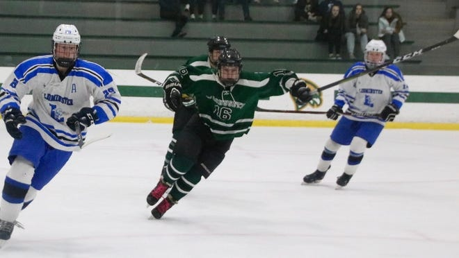 Peyton Marshall, center, on the ice against Leominster in February 2020.
