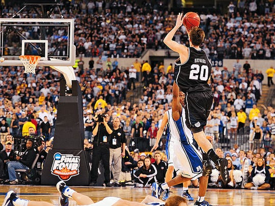 While Singler hits the deck after Howard's crushing screen, Gordon Hayward lofts the halfcourt shot that could have gone down as the greatest in the history of college basketball.