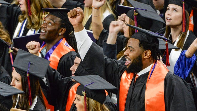 Clemson graduate Christian Wilkins joins in a cadence count at the end of the Clemson graduation in Littlejohn Coliseum on Thursday morning.