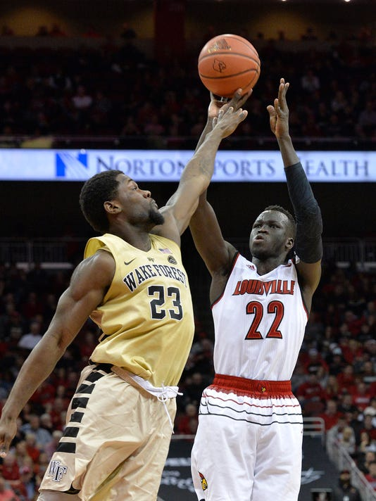 Louisville forward Deng Adel (22) shoots over Wake Forest guard Chaundee Brown (23) during the second half of an NCAA college basketball game Saturday, Jan. 27, 2018, in Louisville, Ky. (AP Photo/Timothy D. Easley)