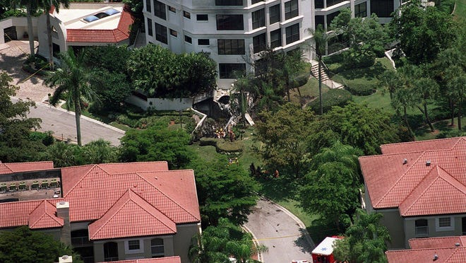 The debris site of a small plane crash is seen in June 2000 at the base of the white, multistory building. It occurred over the Boca Grove Club and Golf Course, which is in the southeast quadrant of the intersection of Glades Road and Florida's Turnpike.