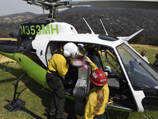 A helicopter belonging to Sequoia and Kings Canyon National Park carrying ariel ignition spheres that were used to aid firefighters in battling the Pier Fire.