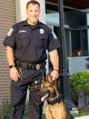 Oak Park Officer Michael Hodakoski is the canine's