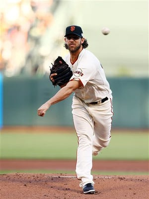 The Giants's Madison Bumgarner throws during the first inning of Game 5 of the World Series on Sunday in San Francisco.