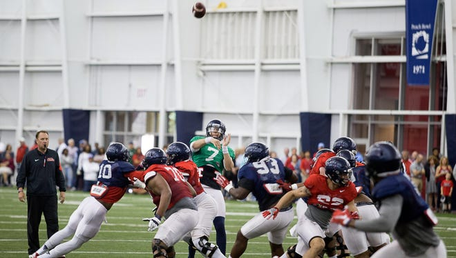 Ole Miss went through a spring scrimmage inside the Manning Center on Saturday instead of a traditional spring game. Coach Hugh Freeze, left, would like to change how schools approach the end of spring practice.