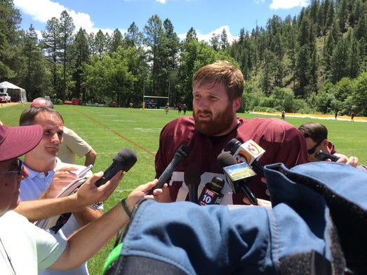 ASU offensive lineman Chip Sarafin talks to the media on Aug. 14, 2014, at Camp Tontozona, a day after a magazine story revealed his homosexuality.