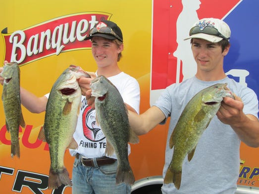 Brennan Banks, left, and Sawyer Collins were on an Ozark High School team. Banks caught the second-largest bass of the tour nament, a 4.49-pounder.