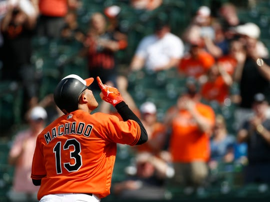 Baltimore Orioles' Manny Machado gestures as he rounds the bases on a solo home run in the third inning of the first baseball game of a doubleheader against the Tampa Bay Rays, Saturday, May 12, 2018, in Baltimore. (AP Photo/Patrick Semansky)