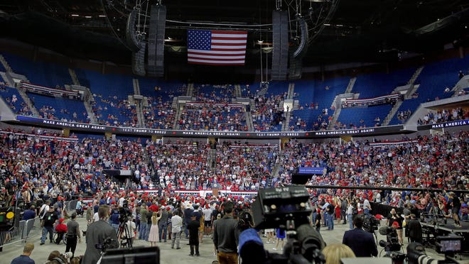 People listen to President Donald Trump speaks during a rally at the BOK Center in Tulsa, Okla., Saturday, June 20, 2020.