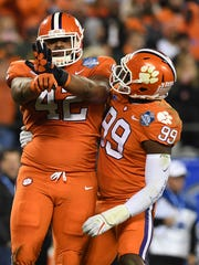 Clemson defensive lineman Christian Wilkins (42) and defensive lineman Clelin Ferrell (99) during the 1st quarter of the ACC championship game against Miami at Bank of America Stadium in Charlotte on Saturday, December 2, 2017.