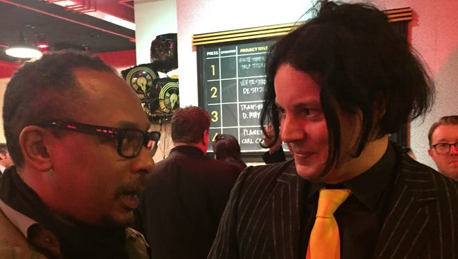 Jack White (right) and techno artist Derrick May chat at Third Man Pressing's opening party, Friday, Feb. 24, 2017.