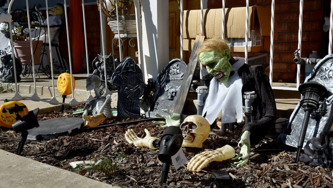 Ghouls and skeletons decorate the front of a house on Royce Court in Camarillo on Monday.