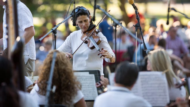 "The Muncie Symphony Orchestra plays their annual ""Festival on the Green"" for the Muncie community on June 10 at Ball State University's Quad. Activities for children including bubble blowing, an instrument petting zoo, Garfield, Charlie Cardinal and more."