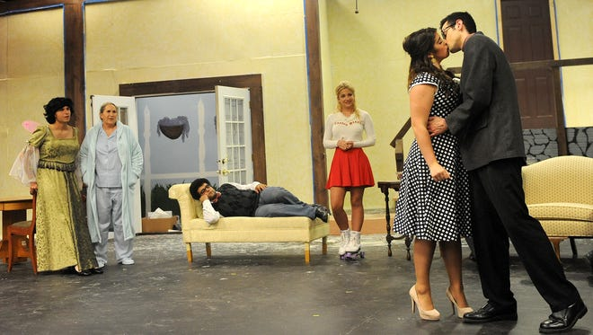 """Maddie O'Donnell and Riley Contipelli share a kiss Tuesday night during a rehearsal of """"Leading Ladies"""" at Founders Auditorium on the OSU-Mansfield campus."""