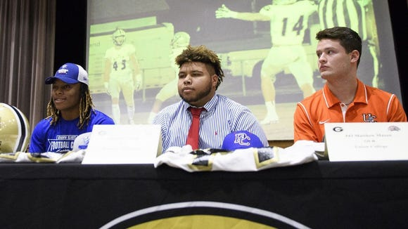From left, Greer High senior football players Qua White (Georgia State), Jalen Terrell (Presbyterian College) and Matthew Mason (Union College) were recognized during a signing ceremony Wednesday in the school's auditorium.