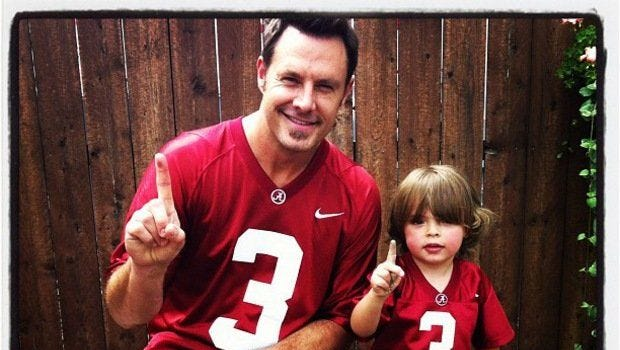 Jimi Westbrook, left, and his son, Elijah Dylan, are pictured in their Alabama football jerseys.
